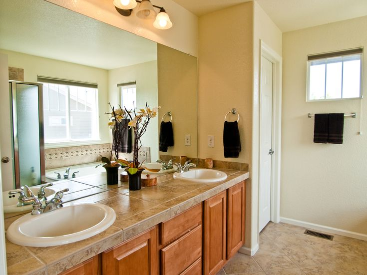 Gallery One Beautiful Master Bathroom with Deco Tiles