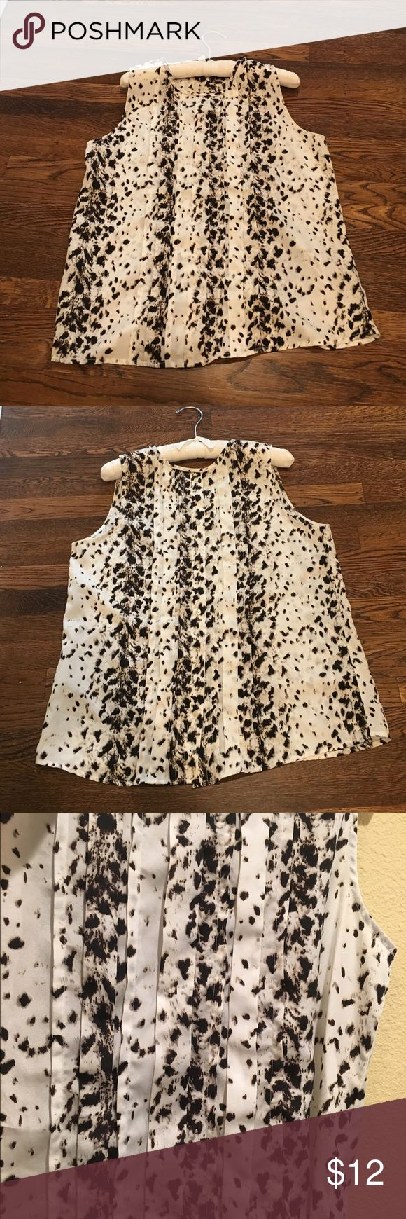 Animal print sleeveless top Airy sleeveless top.  Says Medium, fits like a large.  Pleats in front, buttons up the back... Can really just pull over your head Tops