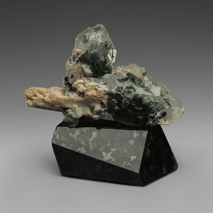 Druse of quartz crystal with inclusions of chlorite and sericite. Mineral`s collection.