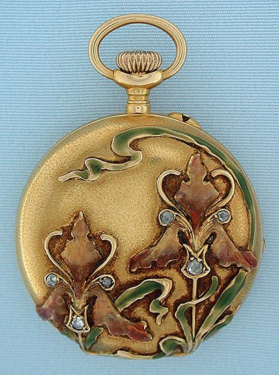 Fine and beautiful Ulysse Nardin 18K gold, diamond and enamel Art Nouveau ladies antique hunting case pendant watch circa 1890. The textured case with high relief enamel and diamond flowers. White enamel dial with blued steel hands. A particularly attractive watch by a famous and highly respected maker. Gilt 16 jewel lever movement