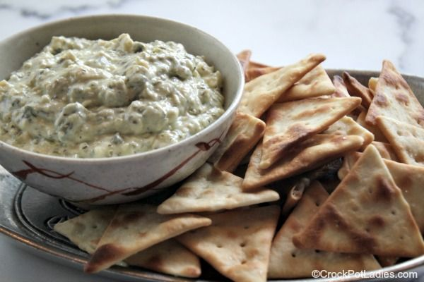 Dip your favorite chips, veggies or bread slices in this simple 5 ingredient recipe for Crock-Pot Asiago Spinach Dip! Full of flavor and so EASY!