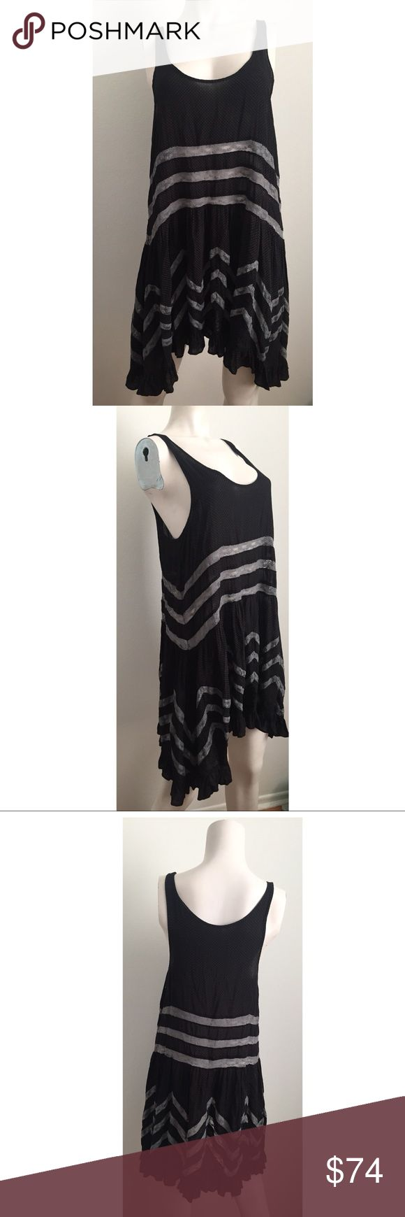 Intimately Free by Free People Asymmetrical Dress Cute and simple dress by Intimately Free by Free People. Can be worn as a short dress or as a long top with leggings. Gray lace insets on the bottom portion of the top. Black polka dot fabric. Free People Dresses