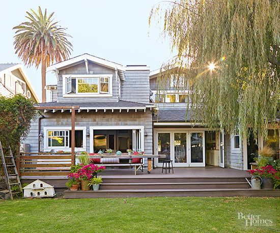 Love the use of shingle siding, sliding glass door leading out to a family size deck