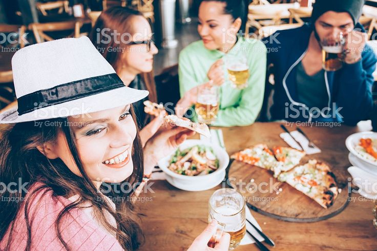 Friends having fun in a bar together royalty-free stock photo