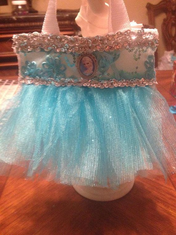 Heres my newest edition! A Frozen Elsa inspired purse lined in silky white! So stinking cute and matches the dress im selling perfectly!