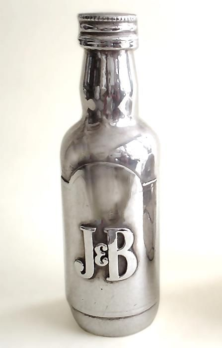 "Shine4ever.gr, can give you solutions in that field as well! Use the product itself to create a piece of art out of it! The ""J&B"" whisky miniature bottle was one of our first cooperations in 1990 in the creation of a unique and branded business gift."