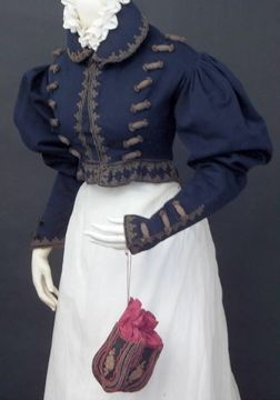 FC0328 Navy wool Spencer jacket with military inspired gilded trim, c. 1830