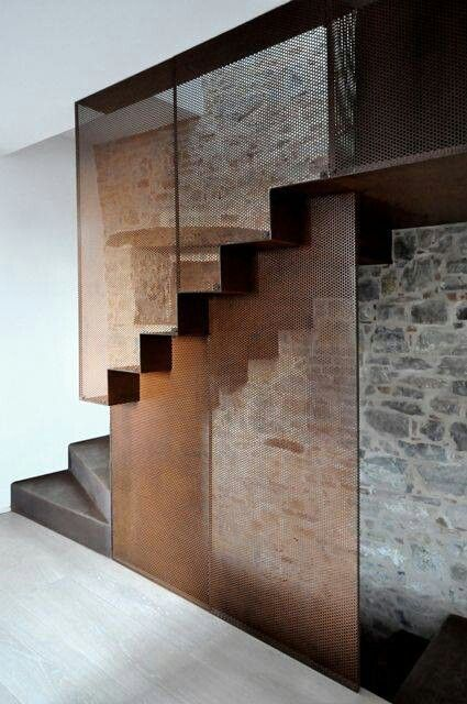 Perforated steel sheet, old stone wall & concrete stair.