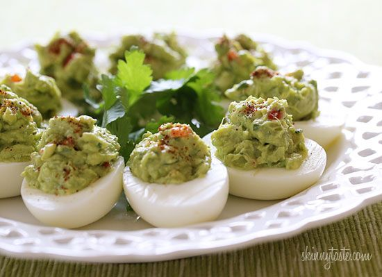 Guacamole Deviled Eggs | 6 large eggs, hard boiled (recipe here) 1 medium haas avocado 2-3 tsp fresh lime juice 1 tsp red onion, minced 1 tbsp minced jalapeno 1 tbsp fresh cilantro, chopped kosher salt and fresh ground pepper, to taste 1 tbsp diced tomato pinch chile powder (for garnish)