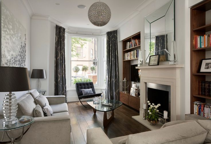 Stylish living room in a modern home in London retaining original period features by NS Interiors
