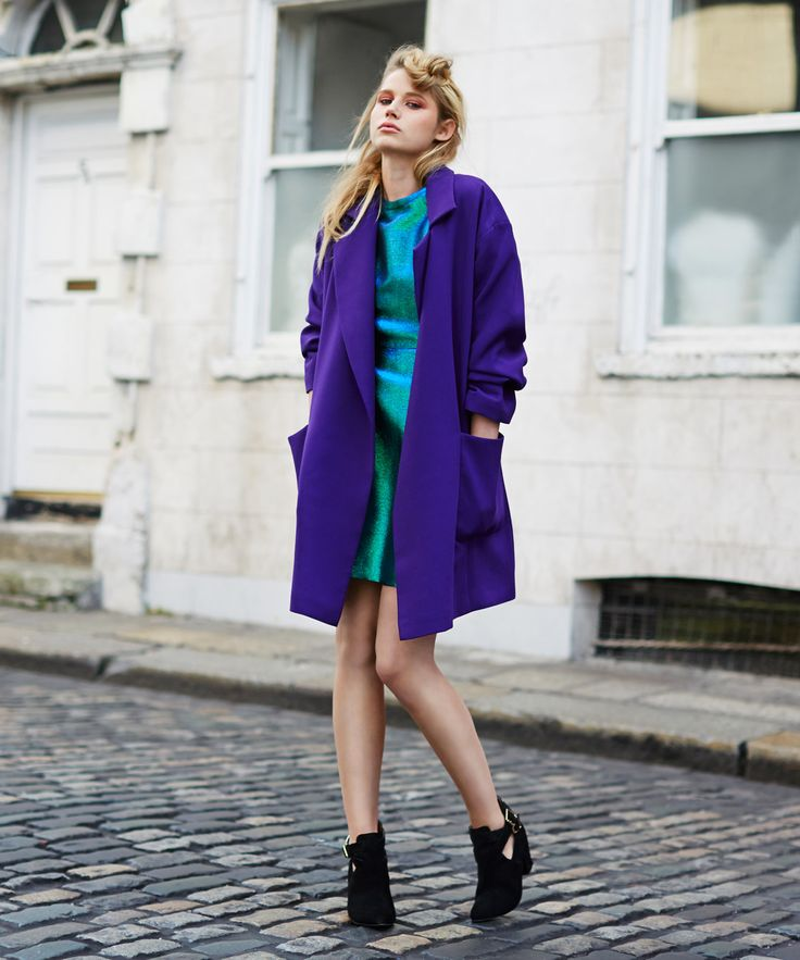 Oversized purple coat with wide sleeves and large pockets by Savida, worn over Savida's textured metallic dress