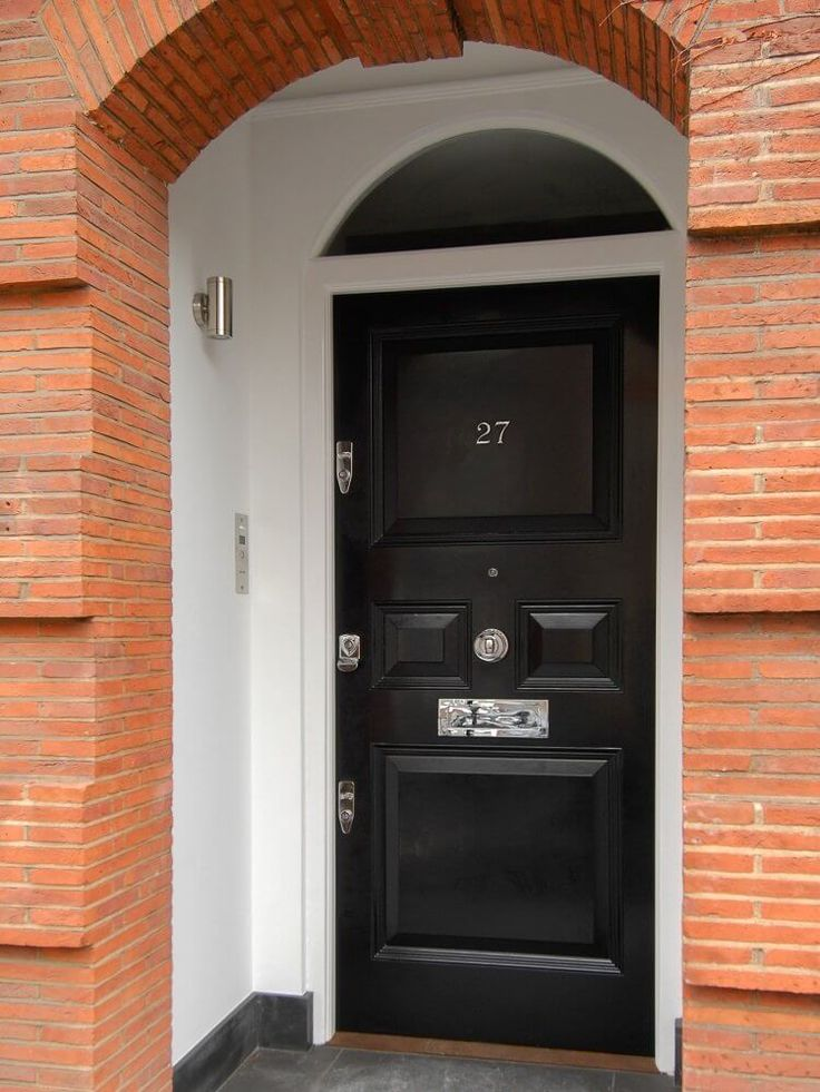 Black timber front door with curved fan light.  Manufactured and installed by The Sash Window Workshop