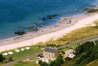 Muasdale Holiday Park, Tarbet, Argyl. A small, family run park on the beautiful west coast of the Kintyre Peninsula. Unobstructed views of the beach, wildlife and nearby islands Gigha, Islay and Jura. Stunning scenery and quiet beaches.