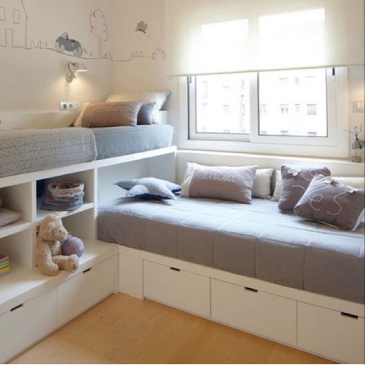 Love the simplicity of these two twin beds with storage. Better then bunk- beds.