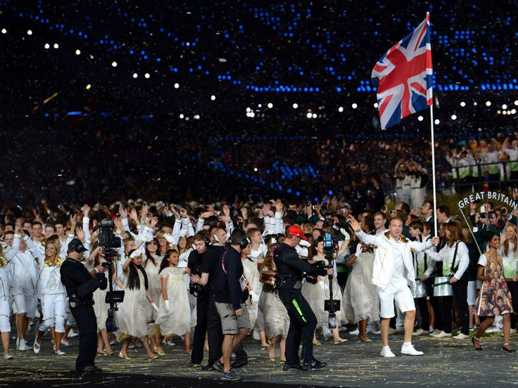 After a very long wait Team GB take to the track, led by flag bearer Olympic legend Sir Chris Hoy; as David Bowie's 'Heroes' blasts around the stadium, London 2012 Opening Ceremony