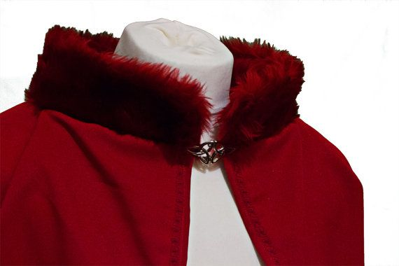 Red cape in bright red with fur collar. This cape is great for a fairytale princess or prince. It can be a great accessory for a winter wedding.