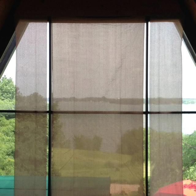 """Custom"" window covering for large window using Sun Screen fabric from DIY center. Blocks the heat and rays from the sun, but not the view. Total cost: less than $15."