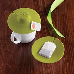 The tea bag buddy from the Container Store: This lil' fella was a Christmas gift. It allows your tea to steep a little longer and you don't have to fight a drippy tea bag as it allows you to grip the tea bag and squeeze it when you're done!