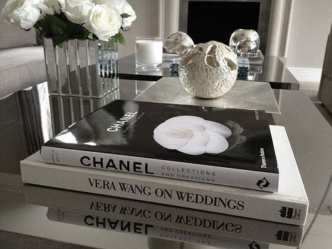 White Roses In Mirrored Cube Perfect Coffee Table Books Silver Ornaments And Candles