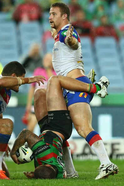 Nathan Peats of the Rabbitohs is tackled by Korbin Sims of the Knights during the round 12 NRL match between the South Sydney Rabbitohs and the Newcastle Knights at ANZ Stadium on June 1, 2013 in Sydney, Australia.