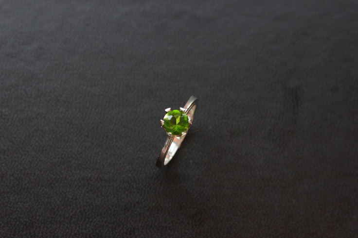 Tapered Sterling Silver Ring with a green claw set cubic zirconia