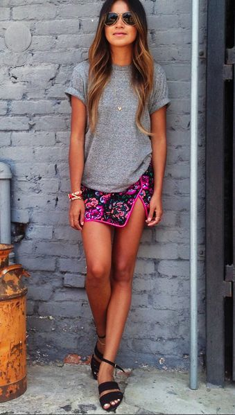 Style with ease: Floral skirt, grey tee and a pair of aviators.