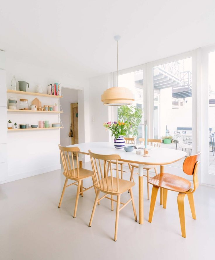 Simple Dining Area With Copper Toned Pendant Light
