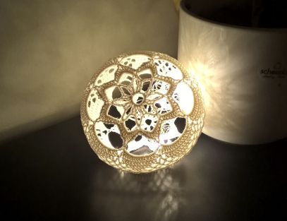 Crocheted light ball -beautiful - to use on a green garland, maybe?