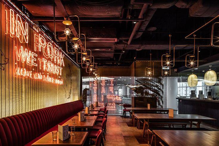 michaelis boyd employs neon detailing inside hong kong's fat pig restaurant