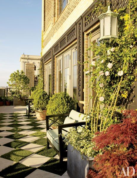Limestone pavers alternate with turf on the terrace off the living area at Bette Midler's New York apartment