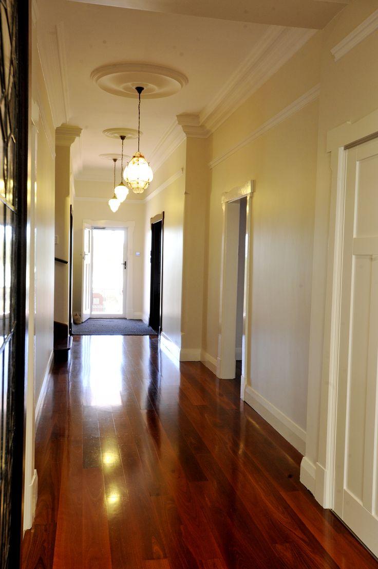 Gleaming jarrah floorboards #hallway #highskirting #highceiling #mthawthorn #blendingoldandnew #perth #renovations #amerex
