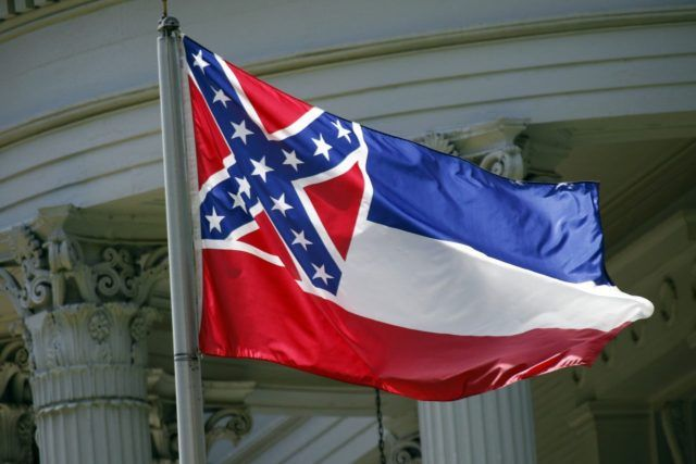 An Ole Miss student was arrested during the football game against Memphis after brandishing the Mississippi State Flag.