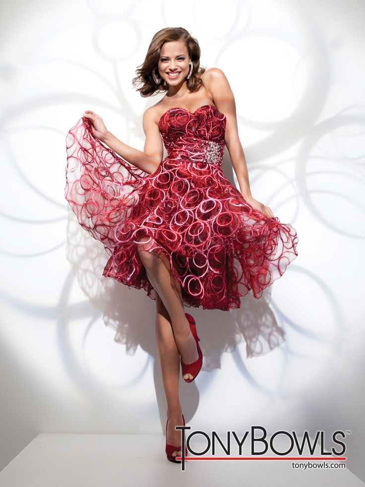 streamer curls, and vibrant. Love it. Red cocktail dress