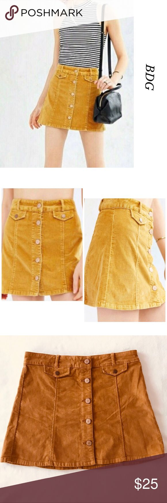 BDG  UO MUSTARD/GOLD CORDUROY MINI SKIRT NOWT, beautiful BDG Urban Outfitters Women's Corduroy Mini Skirt. Perfect for any season. Featuring five front buttons for closure, two small pockets with snap. Color: Mustard/Gold . 98% Cotton 2% Spandex. Line tag to prevent store returns. Bundle and save. Please, feel free to ask me any questions. Urban Outfitters Skirts Mini