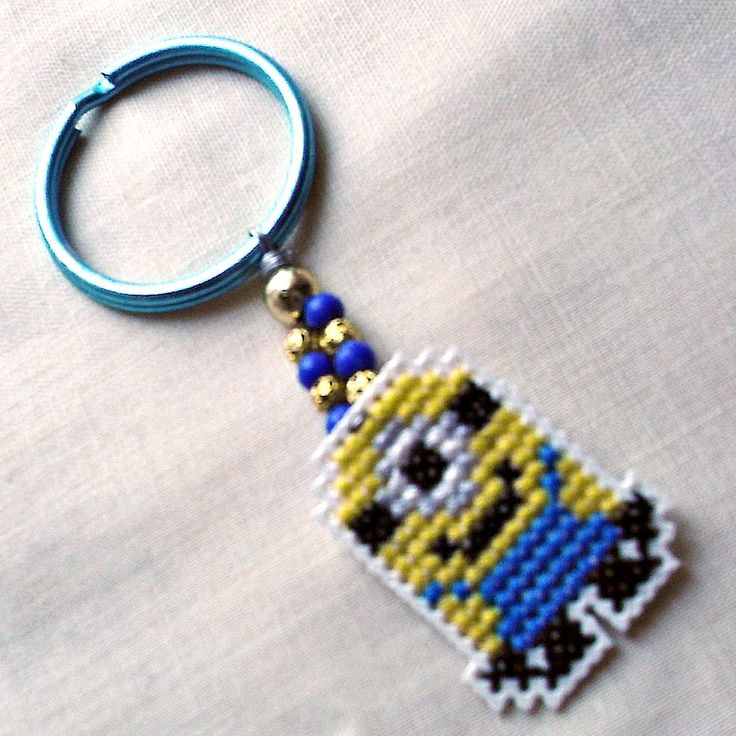 Plastic canvas minion keychain-cross stitched on plastic canvas