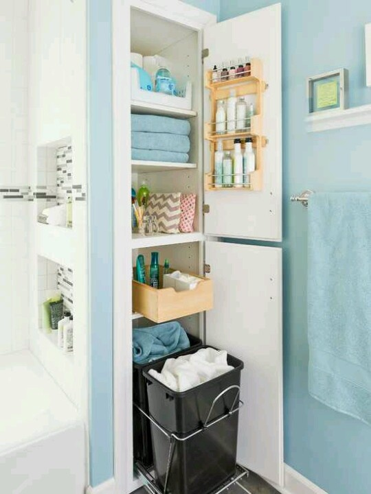 Small closet idea for a bathroom / linen / hall closet.  Love the pull out bins for laundry and the roll-out shelf.