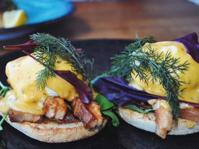 Poached eggs, shaved pork belly, english muffin and Bearnaise from Ascot Food Store'!