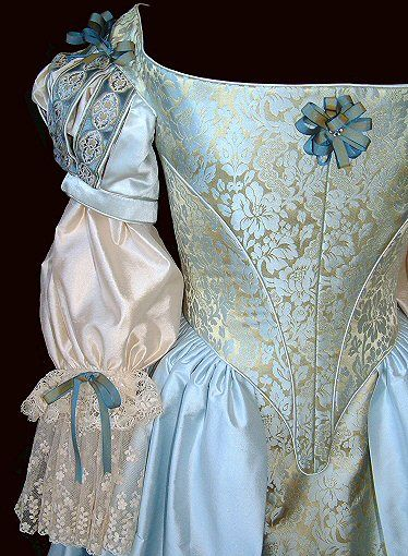 close-up of seventeenth century restoration-style wedding corset and skirt in blue-gold brocade