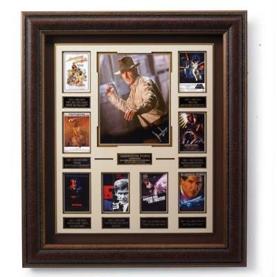 Our Harrison Ford Autographed Movie Collage pays tribute to one of the most successful film stars in Hollywood history. This collage features an autographed        photo of Ford's iconic Indiana Jones character, eight miniature movie posters, plaques with famous quotes from each film, and a strategically placed        replica bullwhip.                            Extremely limited edition                            Authentic Harrison Ford signature                            Beautiful...