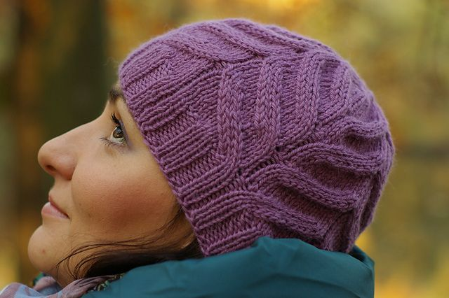 Magnolia is a warm and cozy, close-fitting hat with decorative lacy pattern, which spread around like the petals of a blooming magnolia flower. It is worked in round from bottom – up in one piece. It starts with ribbing. After completing ribbing the hat is worked in simple and intuitive lace pattern.