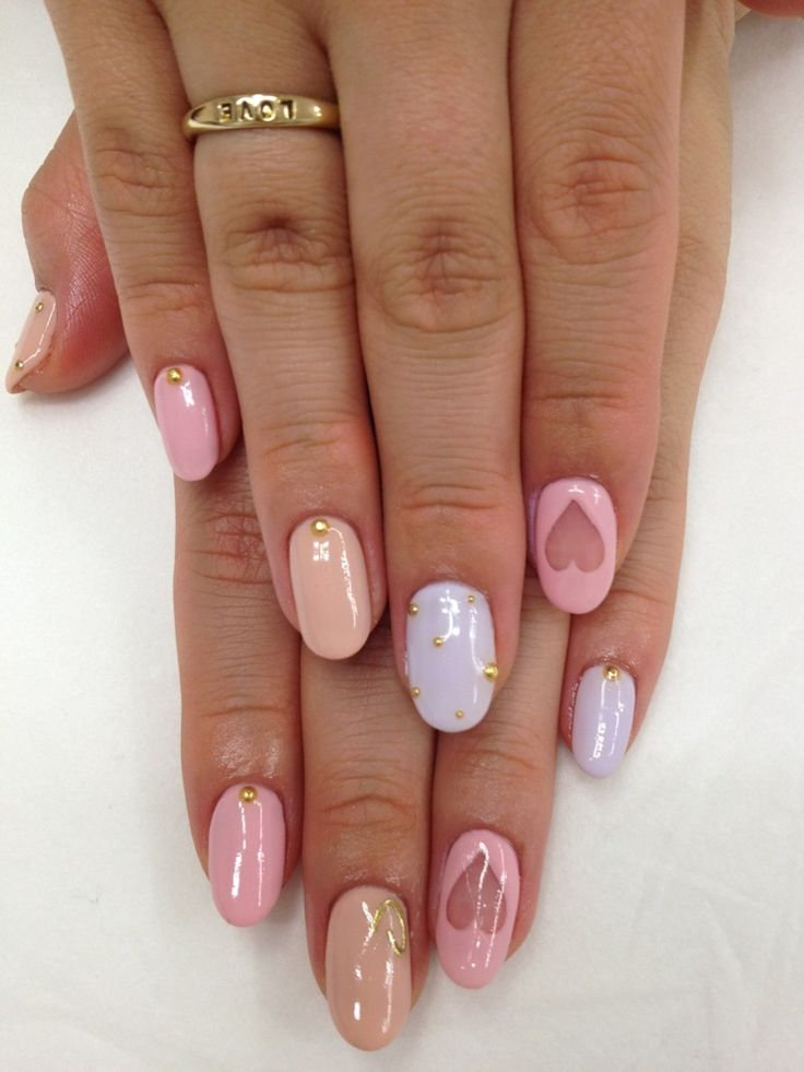 negative space hearts, pastels and gold deco nail art