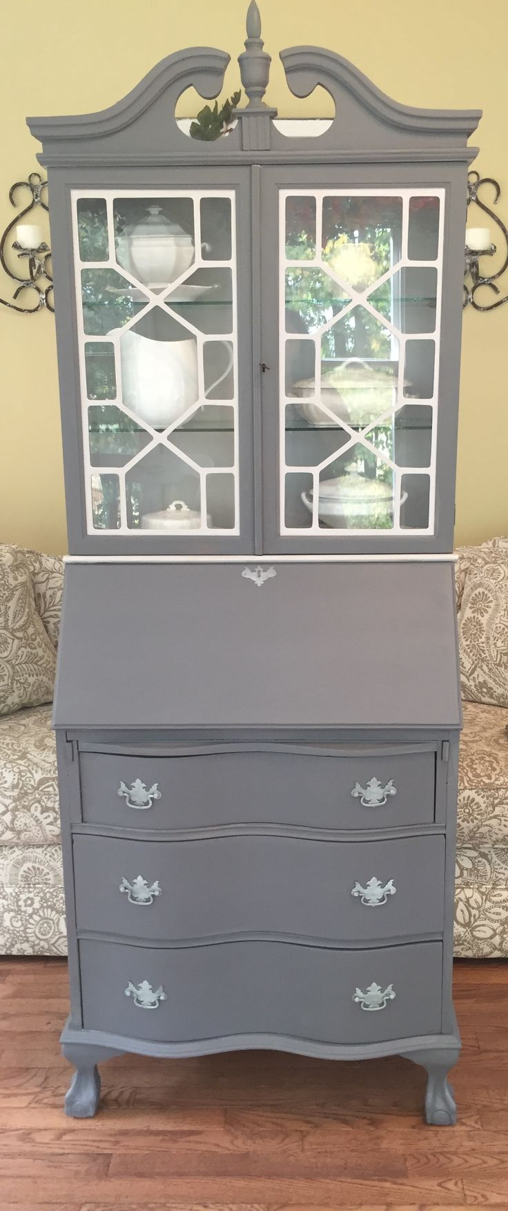 """Beautiful Secretary with serpentine drawers. I will be sad to see this one go. It's been painted in a custom mixed grey and Calm- a very pale grey. 3 drawers and an attached hutch that locks with the original key. The desk area has removable cubbies. This piece measures 77' high to the point x 28"""" wide x 16"""" deep $325.  See it on my facebook page Casa Rinato"""