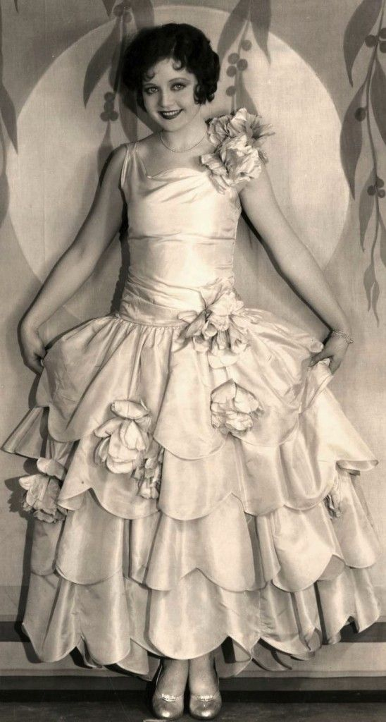 """Talkies Era"" costume--scalloped edges make a ""rose-bloom"" robe de style----(Actress Nancy Carroll-c. 1929)"