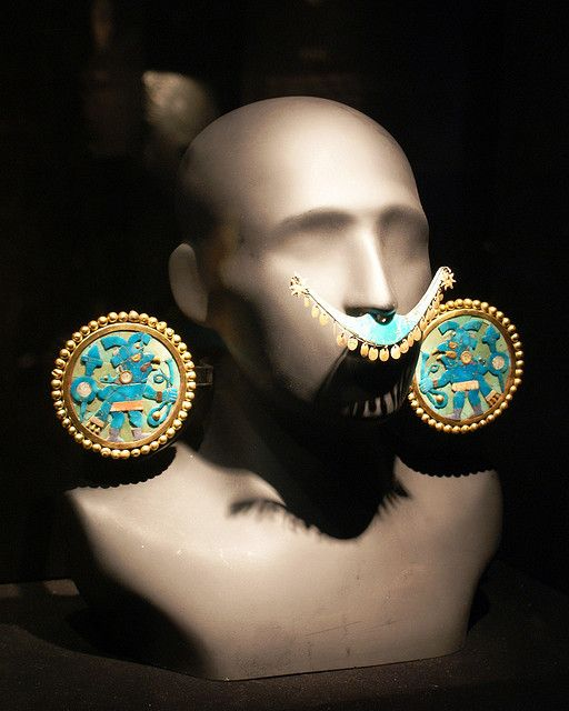 The Gold, turquoise conch and lapis ear ornament. These are made from 1AD to 800 AD. These were created by Museo Larco. (Inca Jewelry)