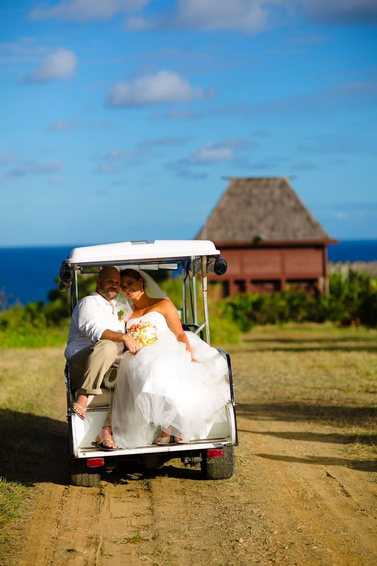Outrigger Fiji Beach Resort Wedding Ideas Planning Inspiration Tropical Paradise Style Floral Design Planning Photography Golf Cart Dress Gown White Hut Outdoors Nature Hillside Oceanside Beach Garden