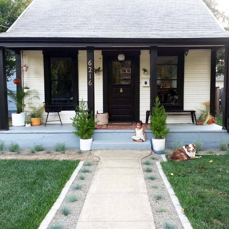 small house with a big back yard and beautiful front yard.