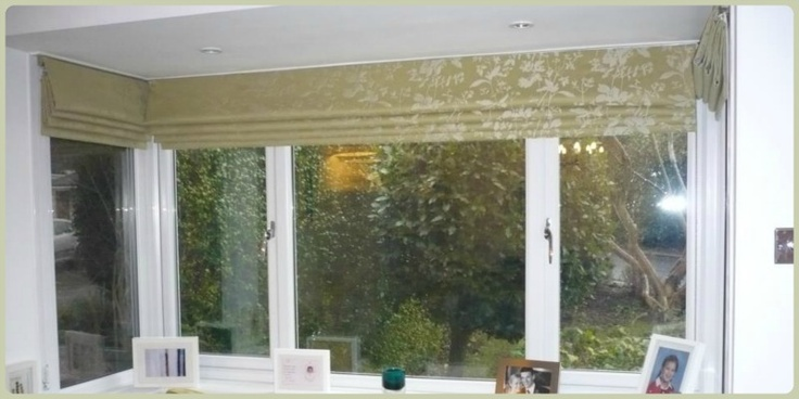 Traditional Roman blinds in a beautiful Sanderson fabric are used to keep this 1920s square bay window clutter free and full of light.
