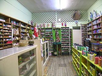 """""""Botánicas such as this one in Jamaica Plain, Massachusetts, cater to the Latino community and sell folk medicine alongside statues of Catholic saints, candles decorated with prayers, lucky bamboo, and other items."""""""