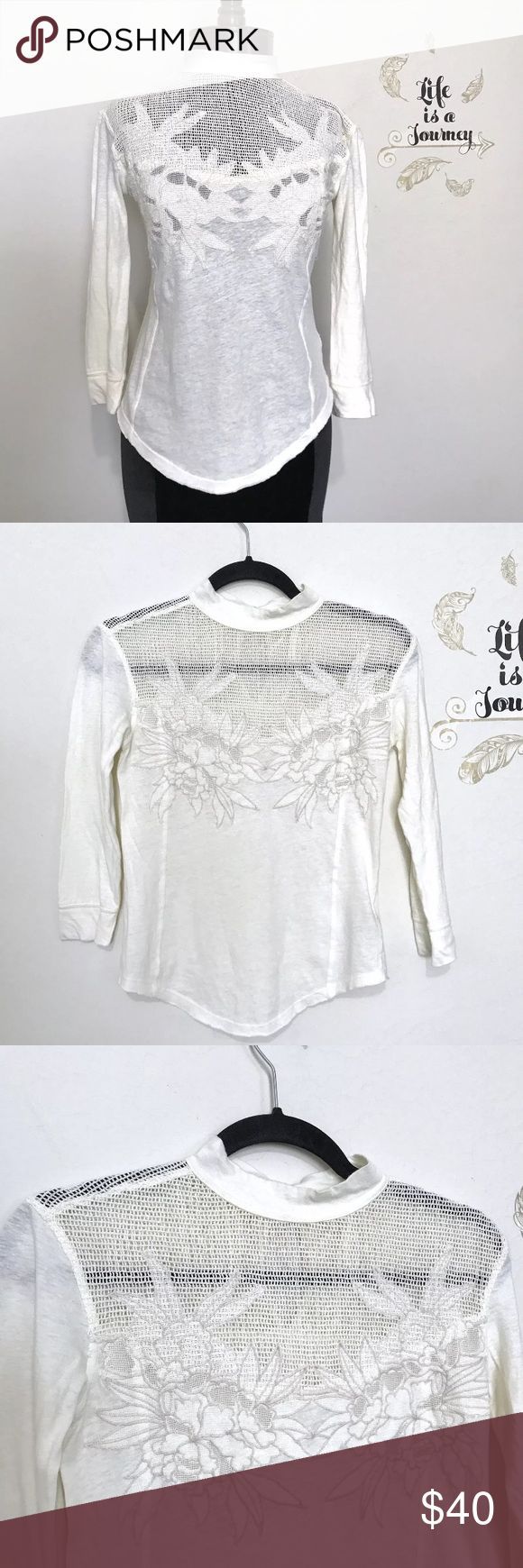 Free People Floral High Neck Cotton Blouse A beautiful off white cotten linen blend blouse with a sheer netting and floral applique bust! Distressed and destroyed hems and a high neck button collar! Excellent condition, small hole at one armpit, as pictured! Pit to pit: 16.5 in Length, shoulder to hem: 19.5 in Sleeve, pit to cuff: 12.5 in Free People Tops Blouses