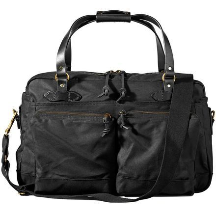 Whether it's an overnight business trip or a quick romantic getaway, arrive in style with the Filson 48-Hour Duffle. The oil-finished twill fabric is water-resistant and tough as nails for long-lasting durability, and it's lined with soft cover cloth for a gentle touch on the interior. Bridle leather handles offer a smooth feel and refined look. A front pocket keeps smaller items separated and close at hand for convenience. And of course it's made in the USA, just like all Filson products…